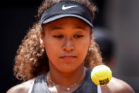 Japan's Naomi Osaka prepares to serve to Japan's Misaki Doi during their match at the Mutua Madrid Open tennis tournament in Madrid, Spain, Friday, April 30, 2021. (AP Photo/Bernat Armangue)