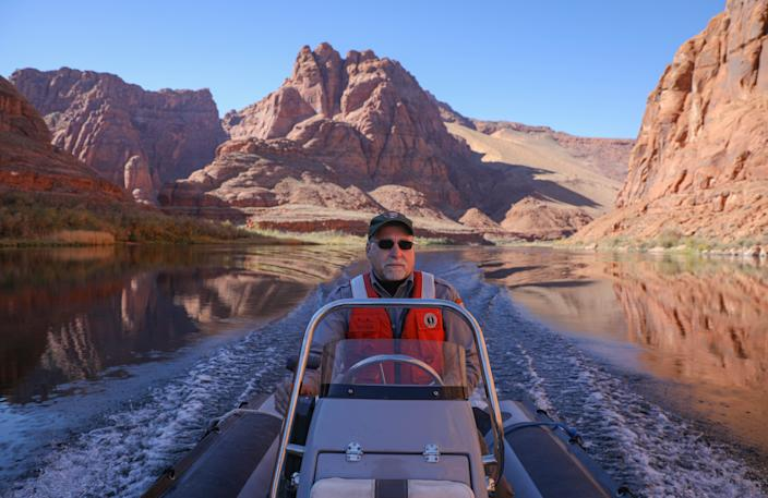 """Jeff Arnold, a fish biologist for the National Park Service at Glen Canyon National Recreation Area, drives down the Colorado River to the Four Mile Bar, which is where he suspects a lot of anglers to be fishing for brown trout. """"It's going to take a lot of people to get this done,"""" he says. """"We need the public and local anglers to do their part, as well."""""""