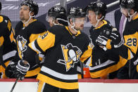 Pittsburgh Penguins' Brian Dumoulin (8) returns to the bench after scoring during the second period of an NHL hockey game against the Buffalo Sabres in Pittsburgh, Thursday, May 6, 2021. (AP Photo/Gene J. Puskar)