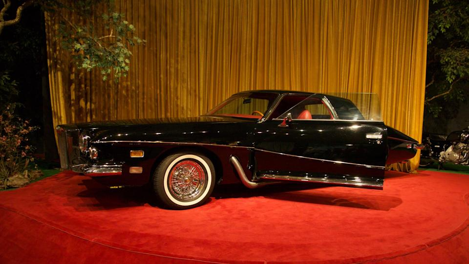 "Sign on the display says: ""Legend has it that this Stutz Blackhawk was originally ordered for Frank Sinatra, but [was] charmed away from the car dealer by Elvis."