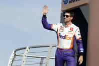 NASCAR Cup Series driver Denny Hamlin (11) waves during driver introductions before a NASCAR Cup Series auto race at the Las Vegas Motor Speedway Sunday, Sept. 26, 2021, in Las Vegas. Hamlin won the race. (AP Photo/Steve Marcus)