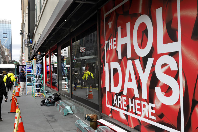 In this Tuesday, Nov. 5, 2019, photo workers trim windows for the upcoming holiday season at the Macy's flagship store in New York. With three weeks until the official start of the holiday shopping season, the nation's retailers are gearing up for what will be another competitive shopping period. (AP Photo/Richard Drew)
