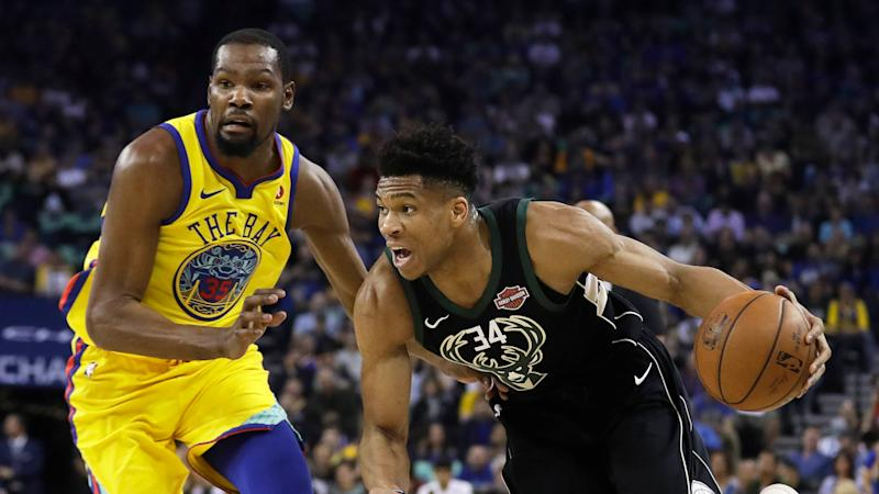 5d70e84c437 Giannis Antetokounmpo says he s still chasing Kevin Durant. (AP)