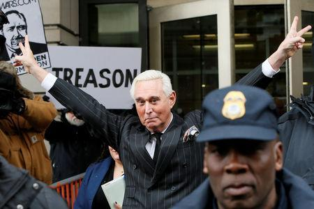 FILE PHOTO: Roger Stone, longtime political ally of U.S. President Donald Trump, flashes a victory gesture as he departs following a status conference in the criminal case against him brought by Special Counsel Robert Mueller at U.S. District Court in Washington, U.S., February 1, 2019. REUTERS/Jim Bourg/Files