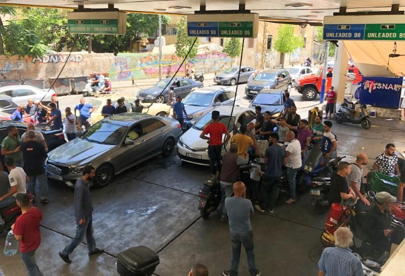 Cars queue for fuel at a gas station in Beirut