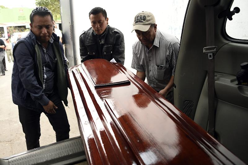 Workers carry the coffin of Keyla Salguero, one of the victims of a fire at a government-run children's shelter in San Jose Pinula, east of Guatemala City (AFP Photo/JOHAN ORDONEZ)