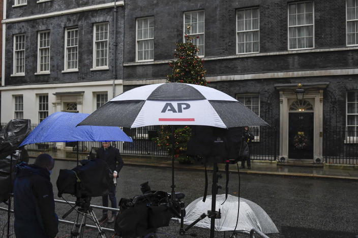 Media outside 10 Downing Street, in London, Sunday, Dec. 13, 2020. Facing yet another self-imposed Brexit deadline on Sunday, the chief negotiators from the European Union and United Kingdom were making last-ditch efforts to scale differences on a trade deal that have proved insurmountable for the best part of the year. (AP Photo/Alberto Pezzali)
