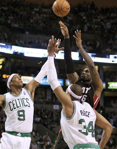 Miami Heat forward LeBron James, right, shoots against Boston Celtics guard Rajon Rondo (9) and forward Paul Pierce (34) during the third quarter of Game 4 in their NBA basketball Eastern Conference finals playoff series in Boston, Sunday, June 3, 2012. (AP Photo/Elise Amendola)