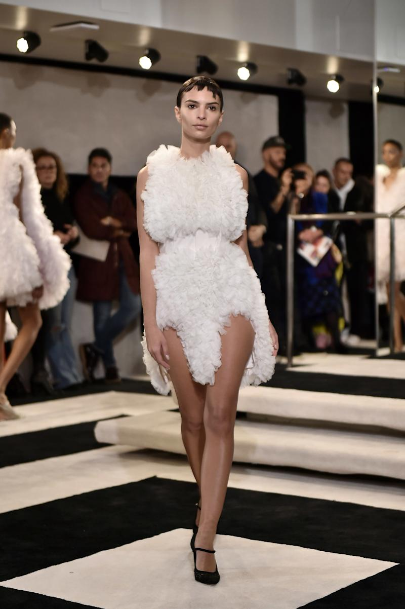 Emily Ratajkowski joined Bella Hadid in channeling a high-fashion loofah on the runway of Tomo Koizumi's fall/winter 2019 show during New York Fashion Week in February 2019.