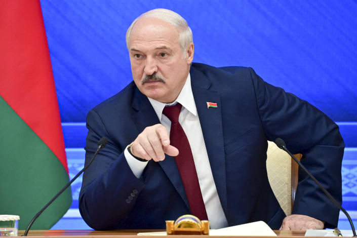 Belarusian President Alexander Lukashenko gestures while speaking during an annual press conference in Minsk, Belarus, Monday, Aug. 9, 2021.Belarus' authoritarian leader on Monday charged that the opposition was plotting a coup in the runup to last year's presidential election that triggered a monthslong wave of mass protests. President Alexander Lukashenko held his annual press conference on Monday, the one-year anniversary of the vote that handed him a sixth term in office but was denounced by the opposition and the West as rigged. (Andrei Stasevich /BelTA photo via AP)