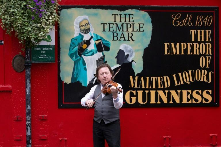 A musician plays during a photocall for a St Patrick's Day online music festival in the Temple Bar area of Dublin