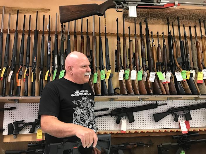 """Sam Scarmardo, head of the Mohave County GOP, at his gun store in Lake Havasu City, Ariz. <span class=""""copyright"""">(Kate Linthicum / Los Angeles Times)</span>"""
