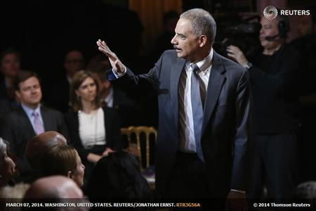 """U.S. Attorney General Eric Holder arrives for a television taping of """"In Performance at the White House: Women of Soul"""" in Washington"""