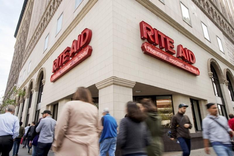 File photo of pedestrians passing a Rite Aid store in Oakland