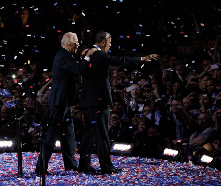 President Barack Obama and Vice President Joe Biden acknowledge the crowd at his election night party Wednesday, Nov. 7, 2012, in Chicago. President Obama defeated Republican challenger former Massachusetts Gov. Mitt Romney. (AP Photo/Nam Y. Huh)
