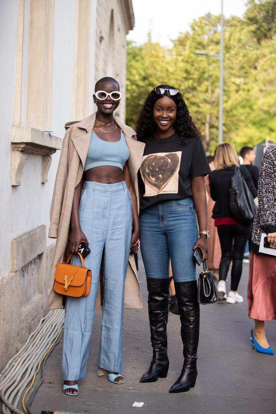 <p>A T-shirt and jeans is an easy combo to throw on, but it's easily dressed with with a simple pair of black thigh-high boots. Add some cat-eye sunglasses, watch, and a top-handle bag before you walk out the door for an outfit that's perfect for transitional temps. </p>
