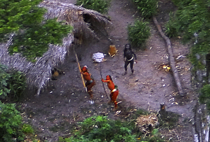 Members of an uncontacted tribe in Brazil's Amazon Basin were photographed by air in 2008. At least 10 members of a tribe in this region were allegedly killed by gold minerslast month. (Ho New / Reuters)