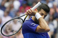 Novak Djokovic, of Serbia, wipes sweat from his face between points during the men's singles final of the US Open tennis championships against Daniil Medvedev, of Russia, Sunday, Sept. 12, 2021, in New York. (AP Photo/John Minchillo)