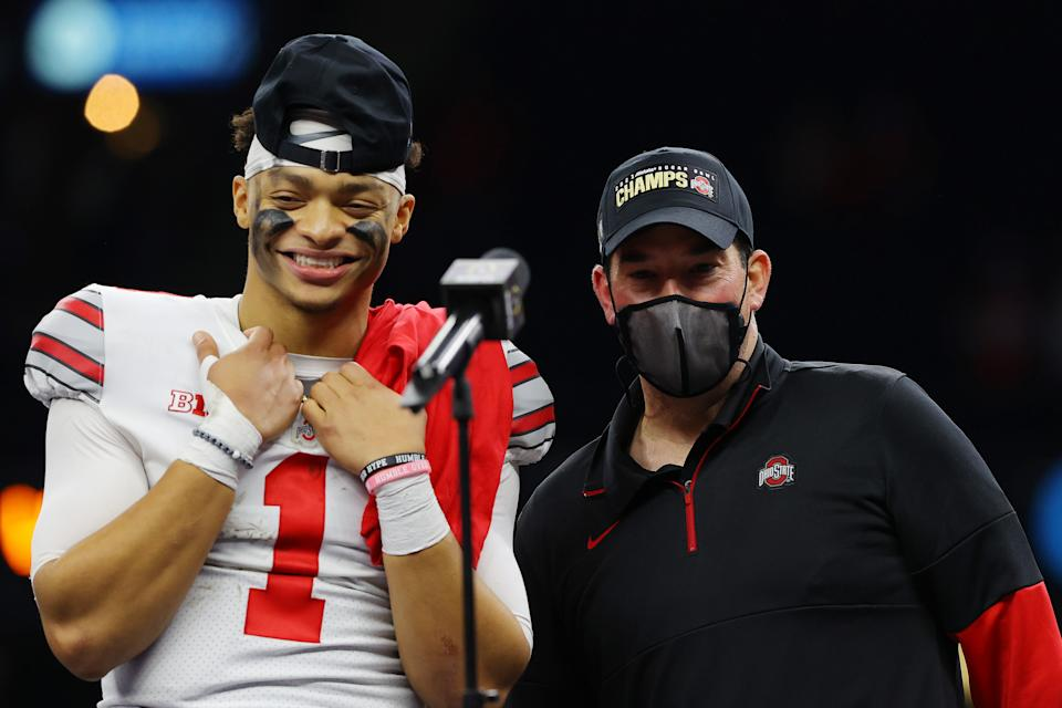 Justin Fields and Ryan Day of the Ohio State Buckeyes react after defeating Clemson, 49-28, in the College Football Playoff semifinal on Jan. 1. (Kevin C. Cox/Getty Images)
