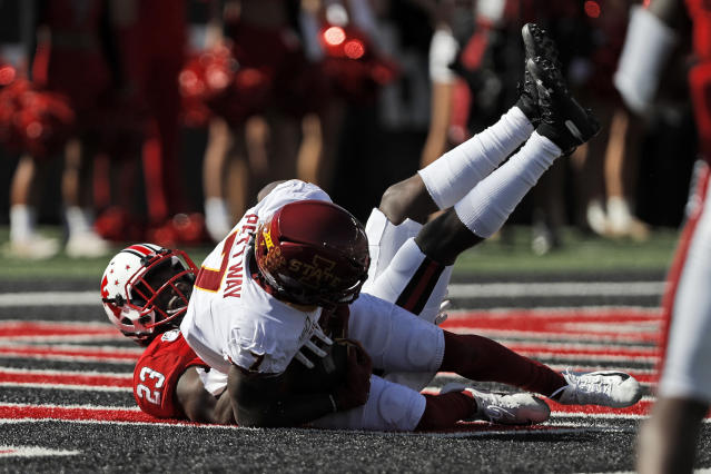 Iowa State's La'Michael Pettway (7) catches a touchdown pass around Texas Tech's Damarcus Fields (23) during the first half of an NCAA college football game, Saturday, Oct. 19, 2019, in Lubbock, Texas. (Brad Tollefson/Lubbock Avalanche-Journal via AP)