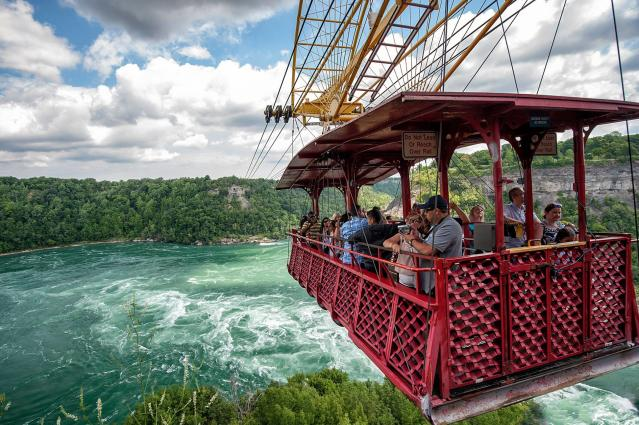 A cable car filled with tourists passes over Niagara Falls. (Facebook)