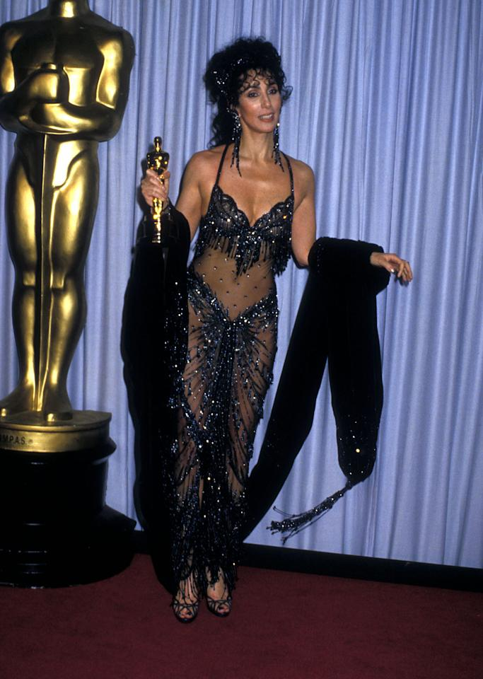 <p>Cher called on her go-to guy Bob Mackie to make her a sheer dress for the 1988 Academy Awards. <em>(Photo: Getty Images)</em> </p>