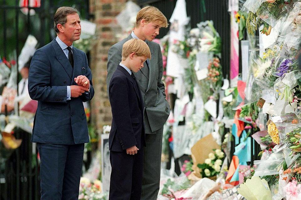 <p>Prince William, Prince Harry, and their father visit memorial tributes to Princess Diana outside of Kensington Palace the week after she died in a car accident in Paris.</p>