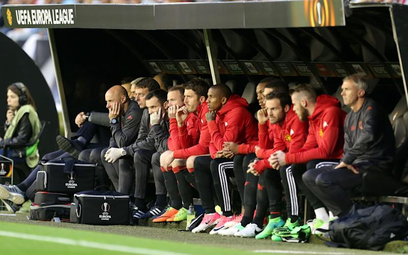 Manchester United's Wayne Rooney sits on the bench - Credit: REX