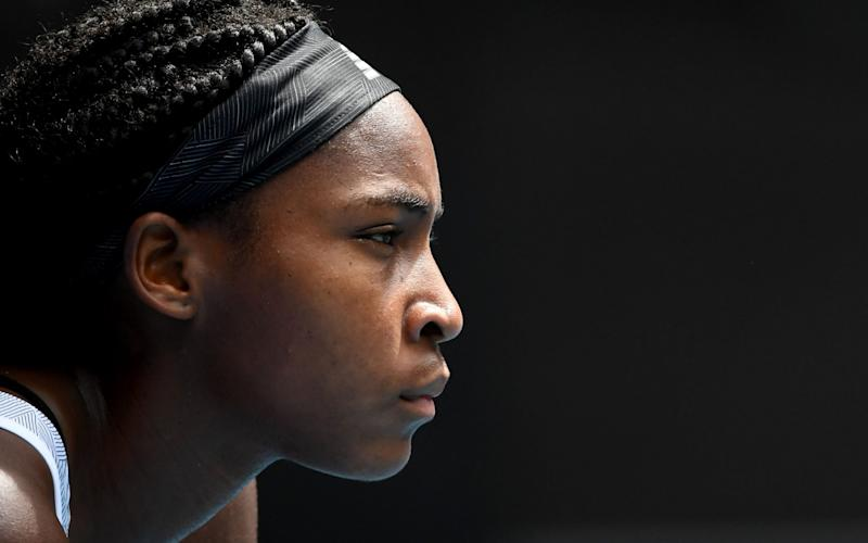 Coco Gauff of the US waits to hit a return against Sofia Kenin of the US during their women's singles match on day seven of the Australian Open tennis tournament in Melbourne on January 26, 2020. - AFP