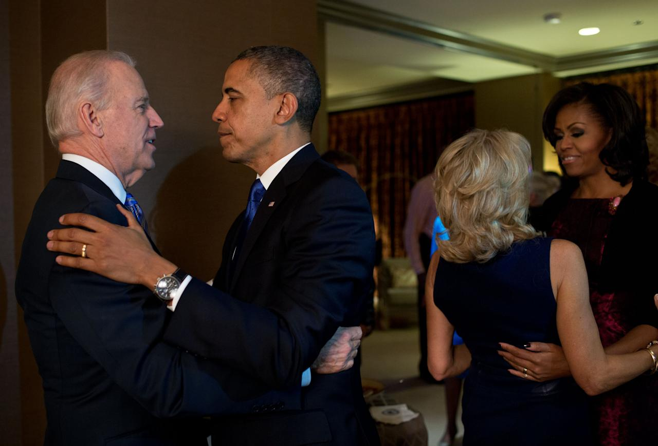 CHICAGO, IL - NOVEMBER 6: In this handout image provided by The White House, U.S. President Barack Obama and first lady Michelle Obama embrace Vice President Joe Biden and Dr. Jill Biden moments after the television networks called the election in their favor, while watching election returns at the Fairmont Chicago Millennium Park on November 6, 2012 in Chicago, Illinois. Obama won reelection against Republican candidate, former Massachusetts Governor Mitt Romney. (Photo by Pete Souza/The White House via Getty Images)