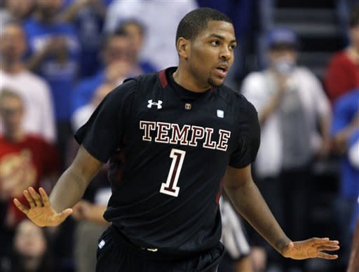 Temple's Khalif Wyatt reacts after hitting a shot during the second half of an NCAA college basketball game against Saint Louis on Wednesday, Jan. 11, 2012, in St. Louis. Wyatt scored 22 points to lead Temple to a 72-67 victory. (AP Photo/Jeff Roberson)