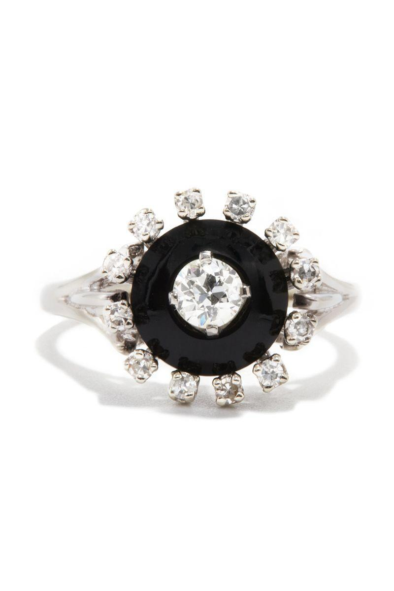"<p><em><strong>Ashley Zhang</strong> Black Onyx and Old European Cut Diamond Ring, circa 1970, $1,550, <a href=""https://ashleyzhangjewelry.com/vintage/black-onyx-and-old-european-cut-diamond-ring"" rel=""nofollow noopener"" target=""_blank"" data-ylk=""slk:ashleyzhangjewelry.com"" class=""link rapid-noclick-resp"">ashleyzhangjewelry.com</a></em></p><p><a class=""link rapid-noclick-resp"" href=""https://ashleyzhangjewelry.com/vintage/black-onyx-and-old-european-cut-diamond-ring"" rel=""nofollow noopener"" target=""_blank"" data-ylk=""slk:SHOP"">SHOP</a></p>"