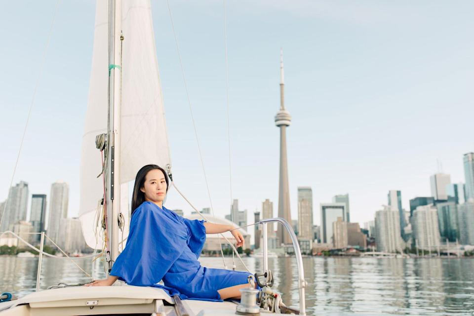 Anna Kim on boat in front of Toronto Skyline