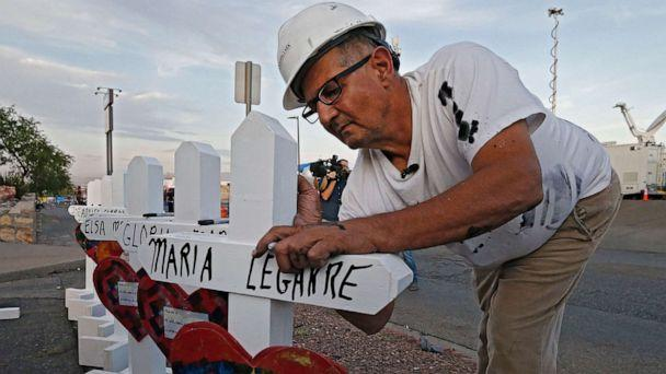 PHOTO: Greg Zanis with Crosses for Losses signs a cross at a makeshift memorial for the victims of a mass shooting that happened at a Walmart in El Paso, Texas, Aug. 5, 2019. (Larry W. Smith/EPA via Shutterstock)