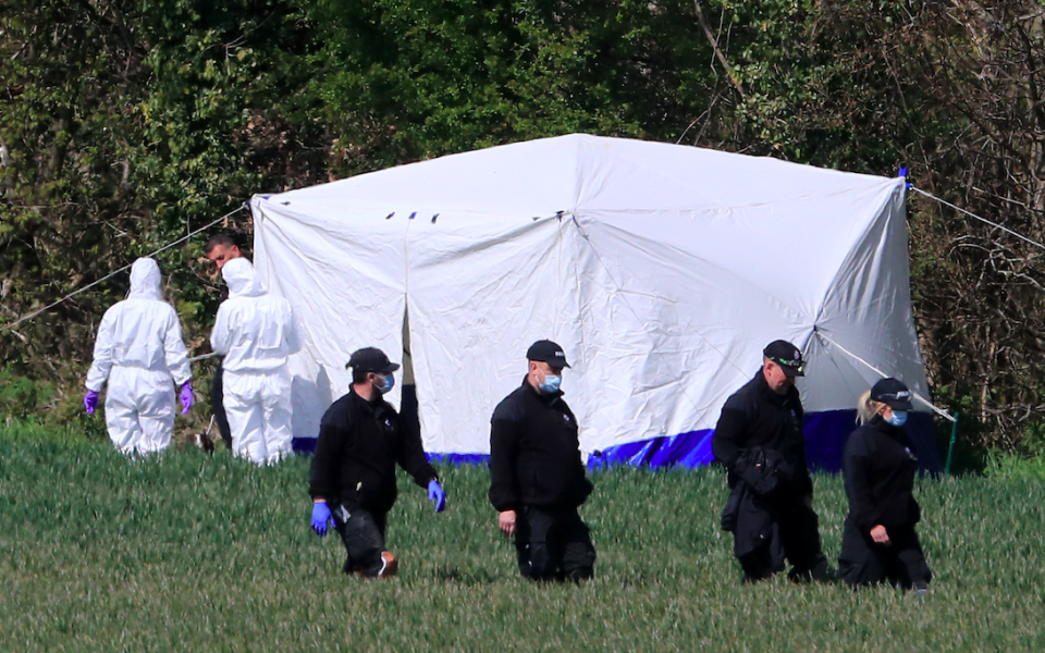 Officers continue to investigate around the area where Julia James' body was found. (PA)
