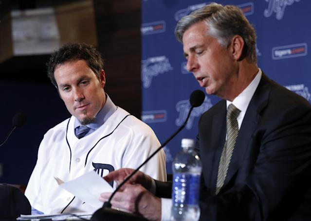 Detroit Tigers pitcher Joe Nathan looks at a list of pitchers that general manager Dave Dombrowski talks about at a news conference in Detroit Wednesday, Dec. 4, 2013. The Detroit Tigers agreed to terms with free agent reliever Nathan on a two-year contract with a club option for 2016 on Wednesday. (AP Photo/Paul Sancya)