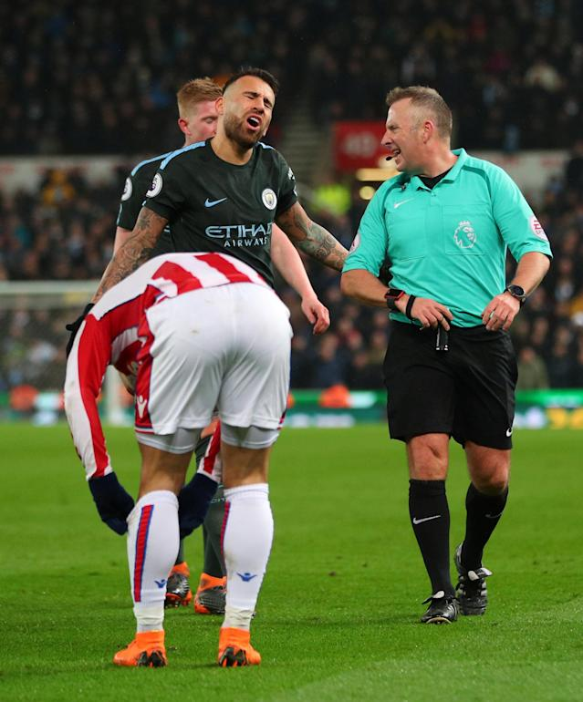 "Soccer Football - Premier League - Stoke City vs Manchester City - bet365 Stadium, Stoke-on-Trent, Britain - March 12, 2018 Manchester City's Nicolas Otamendi reacts with referee Jonathan Moss REUTERS/Hannah McKay EDITORIAL USE ONLY. No use with unauthorized audio, video, data, fixture lists, club/league logos or ""live"" services. Online in-match use limited to 75 images, no video emulation. No use in betting, games or single club/league/player publications. Please contact your account representative for further details."