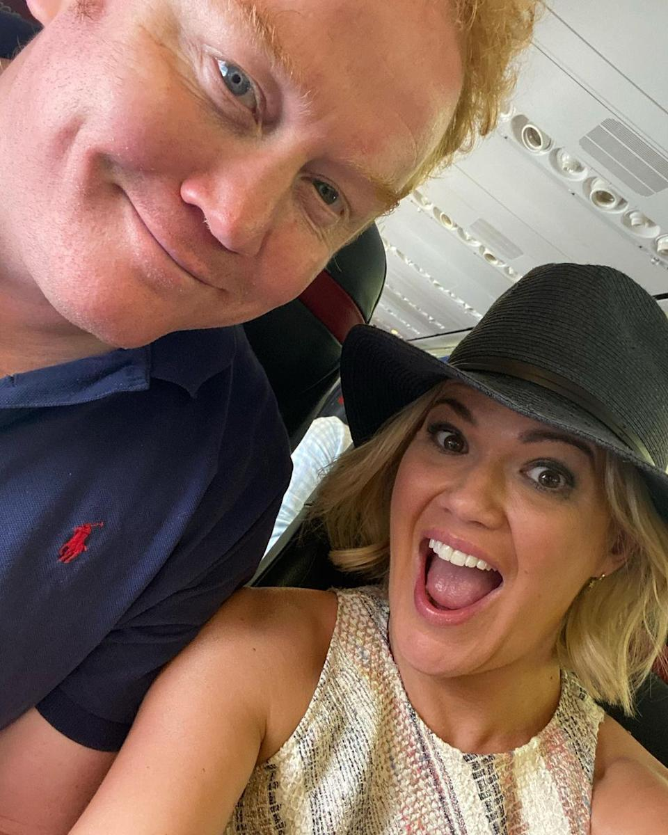 Sarah Harris and her husband, Tom Ward, on a plane