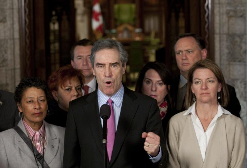 Liberal leader Michael Ignatieff speaks with the media in the foyer of the House of Commons on Parliament Hill in Ottawa on Friday, March 25, 2011 following the defeat of the government. (AP Photo/The Canadian Press, Adrian Wyld)