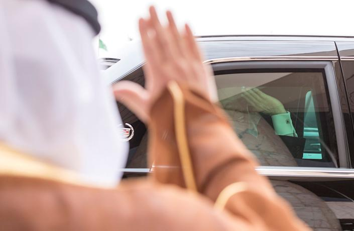Trump waves froma car during the reception ceremony in Riyadh on May 20, 2017.