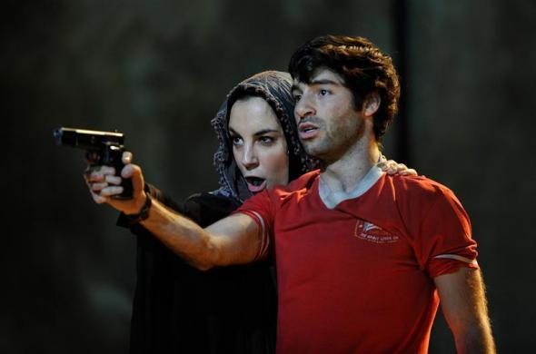 """Clare Presland (L) and Jesse Kovarsky perform during a dress rehearsal of John Adam's opera """"The Death of Klinghoffer"""" at the ENO in London, February 23, 2012."""
