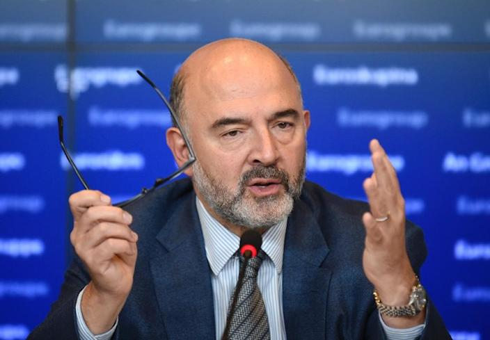EU Commissioner of Economic and Financial Affairs, Taxation and Customs Pierre Moscovici gestures as he speaks during a press conference at a Eurogroup meeting of finance ministers in Luxembourg on October 5, 2015 (AFP Photo/John Thys)