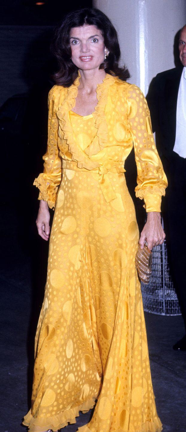 <p>It's anything but mellow yellow in a silk wrap gown. The former First Lady didn't shy from statement-making looks and it paid off. </p>