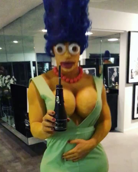 <p>The former <em>Teen Wolf</em> actor could've taken the easy way out and dressed as a werewolf when he hosted a Halloween party in Hollywood. Instead, he spent five hours transforming into sexy Marge Simpson. Whaddya think of the results? (Photo: Instagram/Colton Haynes) </p>