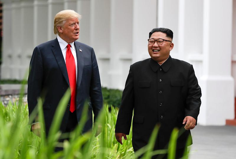 President Trump and North Korea leader Kim Jong Un walk from their lunch at the Capella resort on Sentosa Island in Singapore on June 12, 2018.