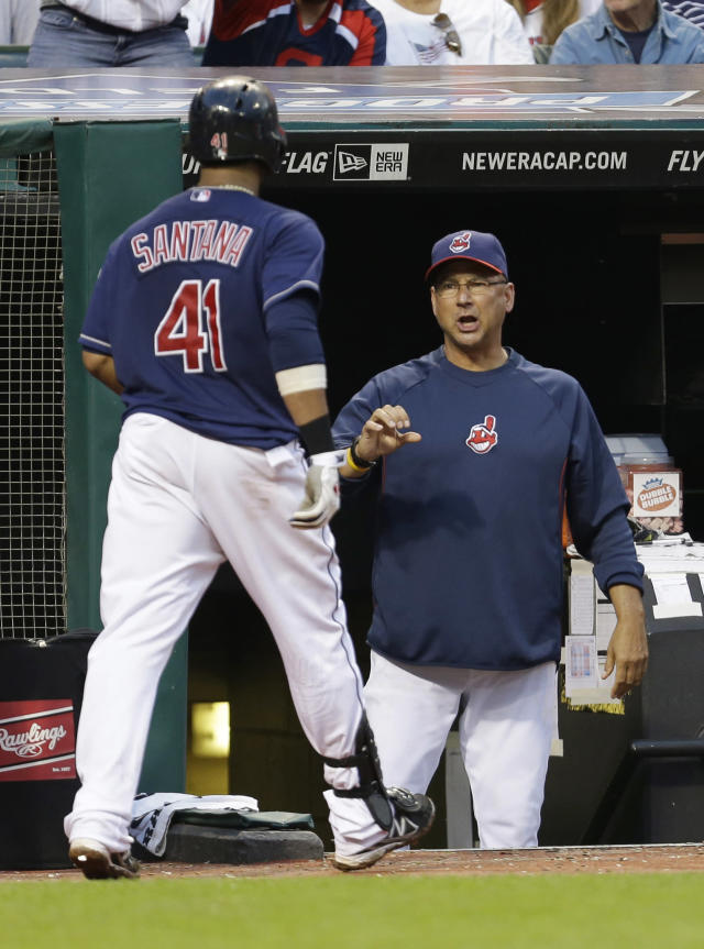Cleveland Indians' Carlos Santana, left, is congratulated by manager Terry Francona after Santana hit a solo home run off Washington Nationals starting pitcher Jordan Zimmermann in the fourth inning of a baseball game, Saturday, June 15, 2013, in Cleveland. (AP Photo/Tony Dejak)
