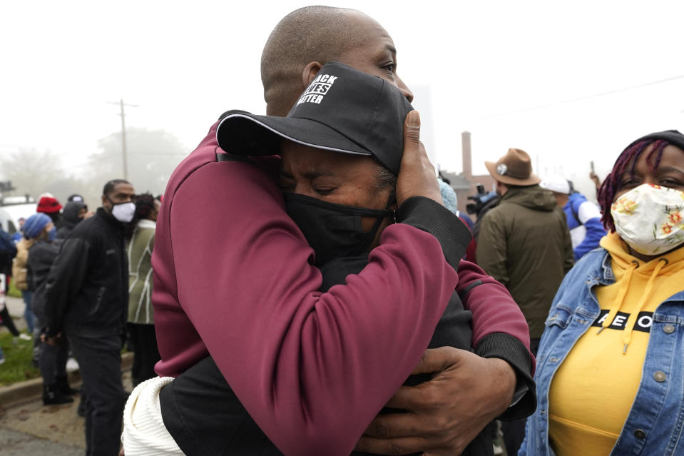 Marcellis Stinnette's grandmother Sherrellis Stinnette, right, cries as she hugs Rayon Edwards during protest rally for Marcellis Stinnette who killed by Waukegan Police Tuesday in Waukegan, Ill., Thursday, Oct. 22, 2020. Stinnette, 19, was killed and his girlfriend and the mother of his child, Tafara Williams, was wounded when a police officer in Waukegan opened fire Tuesday night after police said Williams' vehicle started rolling toward the officer following a traffic stop. (AP Photo/Nam Y. Huh)