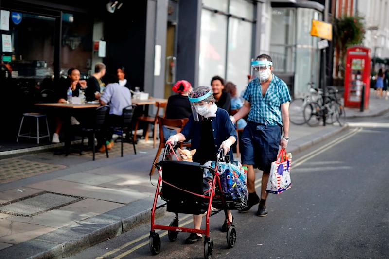Londoners out and about during sunny weather after lockdown restrictions were eased (AFP via Getty Images)