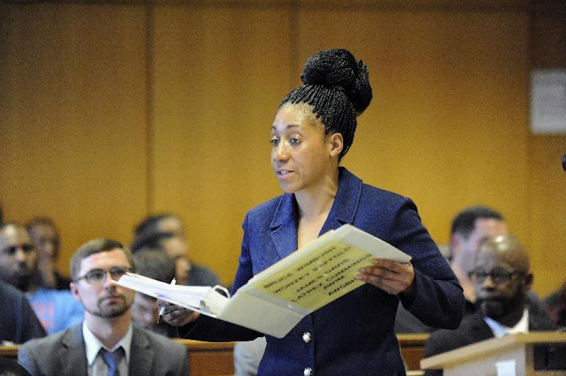 Wayne County Assistant Prosecuting Attorney Lisa Lindsey speaks before Judge Thomas Jackson at Frank Murphy Hall of Justice, Monday, April 21, 2014, in Detroit. The four men who were accused of punching and kicking motorist, Steve Utash, who accidentally struck a 10-year-old Detroit boy, were ordered Monday to stand trial on attempted murder charges. (AP Photo/Detroit News, David Coates) DETROIT FREE PRESS OUT; HUFFINGTON POST OUT