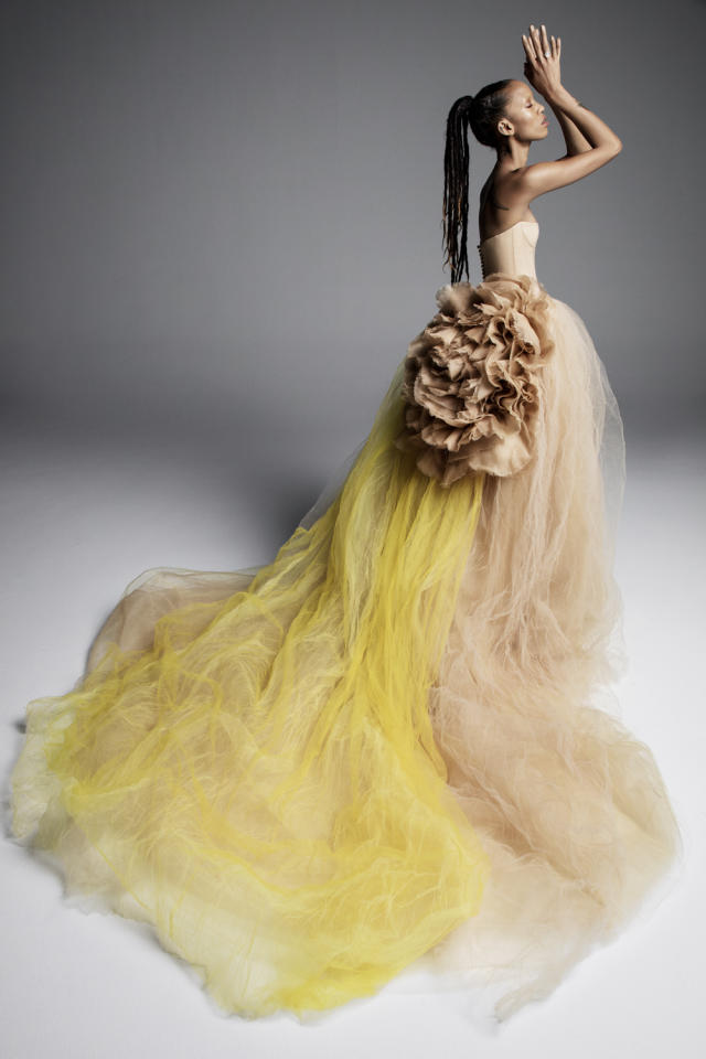<p>Strapless yellow and beige gown with train and statement flower. (Photo: Inez & Vinoodh/Vera Wang ) </p>